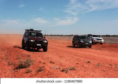 4wd off road vans on red soil Outback Australia