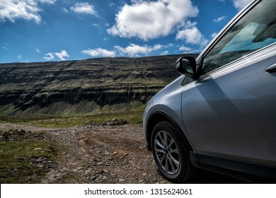 4WD SUV vehicle car running on gravel road with nature mountain landscape in Iceland. Adventure and extreme sport.