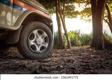 4x4 car concept with big offroad wheel. White car tourist police in the woods of Havelock island, Andaman and Nicobar Islands, India