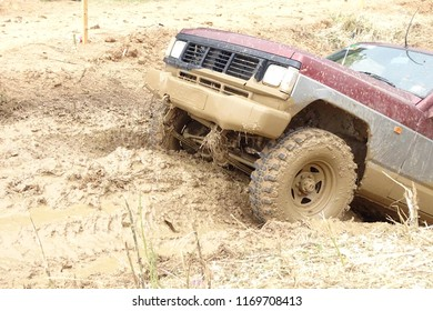 4x4 jeep in a big puddle with mud, adventure in a car outdoors. Llinars del Valles, Catalonia, Spain. 3 June 2018