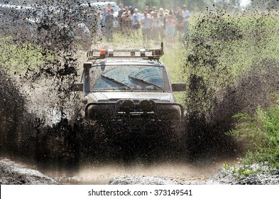 4x4 Off-road car in a puddle making mud splashes.