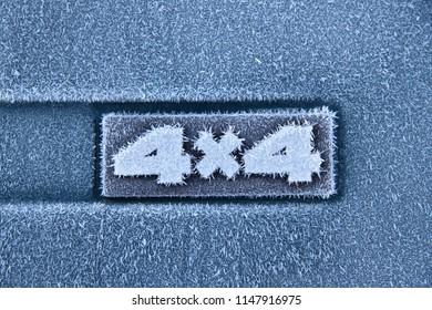 A 4x4 vehicle badge frozen
