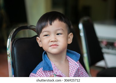 4-year-old boy in Thailand are sitting to eat fruit.