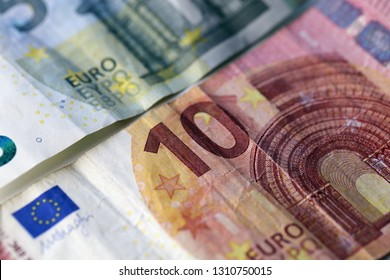 5 and 10 euro banknotes in a closeup photo taken with a macro lens. Color image. Photographed in Kuopio, Finland during February 2019.