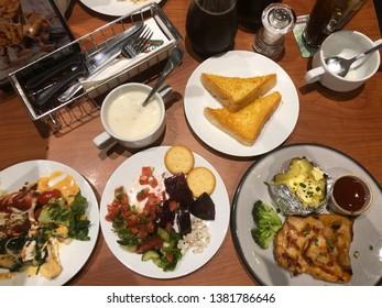 5 April 2019; Bangkok Thailand: Table of salad and steak at Sizzler, steak and salad restaurant.
