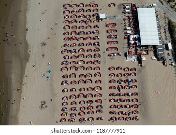 5 August 2018, Noordwijk aan Zee, Holland. Aerial shot of a crowded beach on a sunny, hot day at the Dutch coast. The patterns with the windshields give an abstract view.