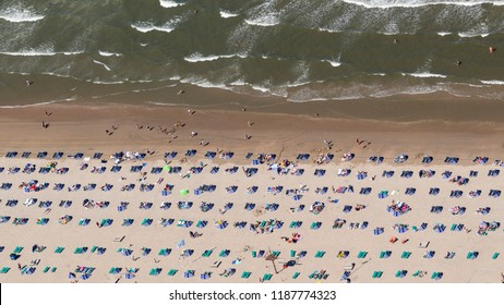 5 August 2018, Zandvoort aan Zee, Holland. Aerial view of a crowded beach on a sunny, hot day at the Dutch coast in Zandvoort. There is a nice pattern of windshields and people in the sand.