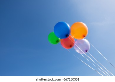 5 balloon with clearly blue sky