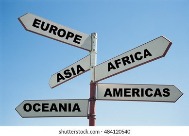 5 continents of the world on a sign post