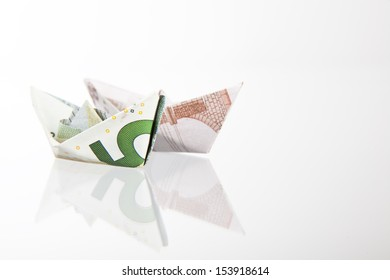 5 euro paper ship on white background