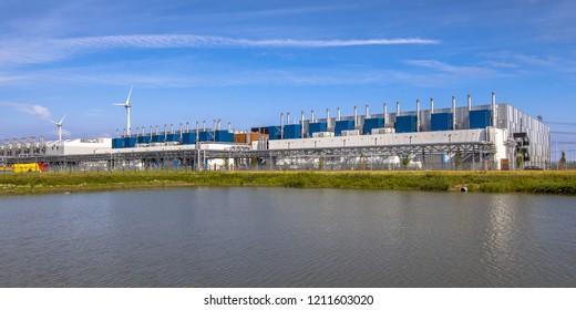 5 JULY 2016, EEMSHAVEN, NETHERLANDS. Google Datacenter near Delfzijl in the province of Groningen under blue sky.