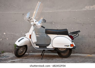 5 July 2017 - Salerno, Italy -  Traditional italian scooter - Vespa on the sidewalk in Salerno