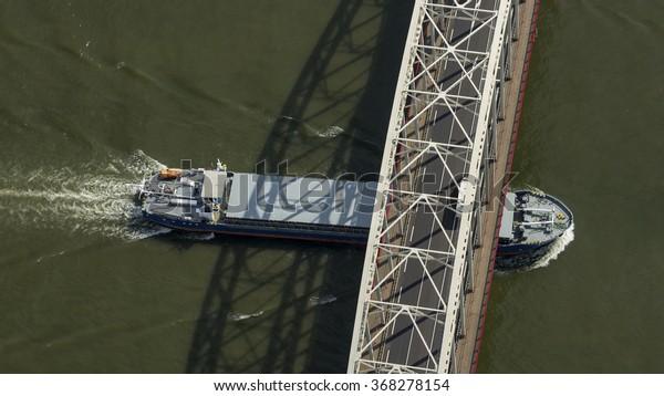 5 June 2015, Alblasserdam, The Netherlands. Aerial view of barge passing a bridge in Alblasserdam.