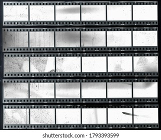 5 long and empty or blank 35mm filmstrips, black and white film material behind real foil, cool retro photo placeholder.