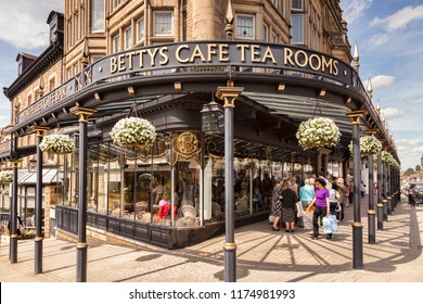 5 May 2016: Harrogate, North Yorkshire, England, UK - Bettys Cafe Tea Rooms, and a queue waiting outside to go in.