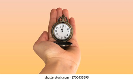 5 minutes to 12 o'clock. Old pocket watch in young woman's hand. Negative space. Copy space for advertising.