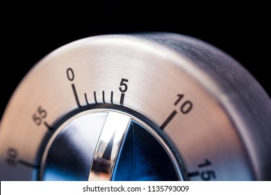 5 Minutes - Macro Of An Analog Chrome Kitchen Timer With Dark Background