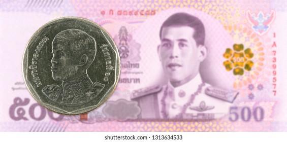 5 new thai baht coin against 500 new thai baht banknote