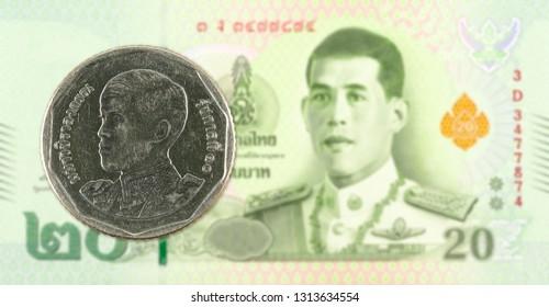 5 new thai baht coin against 20 new thai baht banknote
