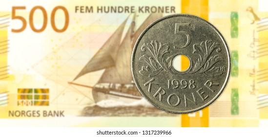 5 norwegian krone coin against 500 new norwegian krone banknote