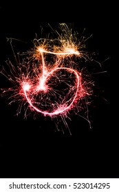 """""""5"""" number drawn with bengali sparkles isolated on black background,number from sparkler on black background"""