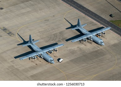 5 October 2018, Eindhoven, Holland. Aerial view of two Royal Dutch Air Force Lockheed C-130 Hercules military transport planes parked at Eindhoven Airport in Holland.