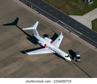 5 October 2018, Eindhoven, Holland. Aerial view of the Gulfstream , V-II, of the Koninklijke Luchtchtmacht, RNLAF Dutch Air Force. It is stationed at Eindhoven Airport and a van is parked next to it.