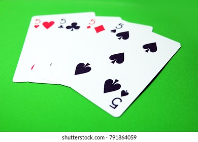 5 Playing Card Game. Old Five of Heart, Spades and Diamonds Playing Cards Isolated On Green Background Great for Any Use.