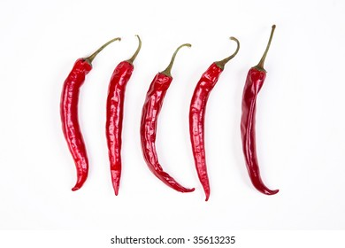5 Red chili peppers on white