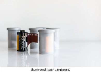 5 rolls of Kodak Portra 160 35mm camera film isolated on white background. Photographed: May, 2019.