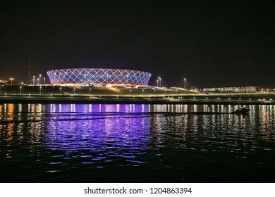 5 September, 2018 Volgograd, Russia. Night illuminated view of the new football stadium Volgograd Arena froom the river side.