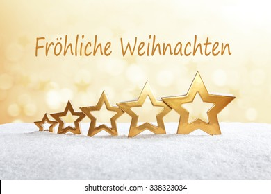 5 stars on snow in front of bright yellow light, text, fröhliche weihnachten, merry christmas, german,