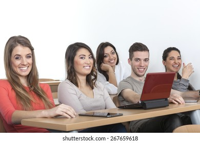5 students laughing in the lecture hall