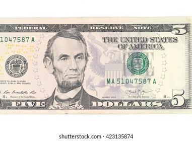 5  US dollar money isolated on white.