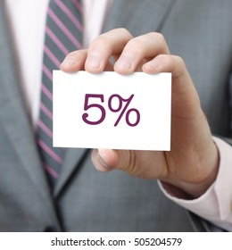 5% written on a card held by a businessman