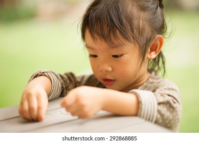 5 year old Asian Chinese girl playing