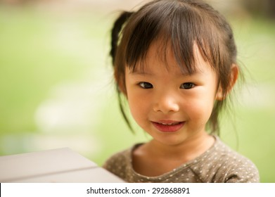 5 year old Asian Chinese girl smiling