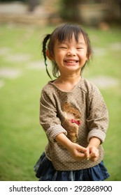 5 year old Asian Chinese girl making faces