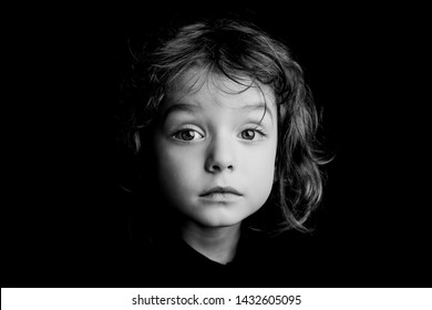 5 year old boy with long hair black and white studio portrait