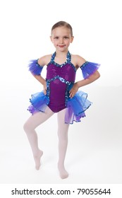 5 Year old girl with dancing costume on a white background