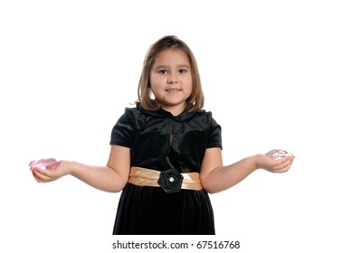 A 5 year old girl holding fake diamonds in her hands, isolated against a white background.