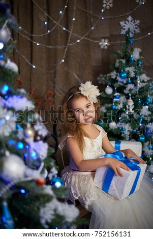 A 5 year old girl in the studio with Christmas decorations of gifts Year Old Girl Studio Stock Photo (Edit Now) 752156131