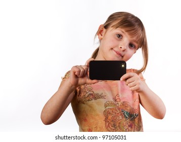 5 year old girl taking a flash picture with a smart phone