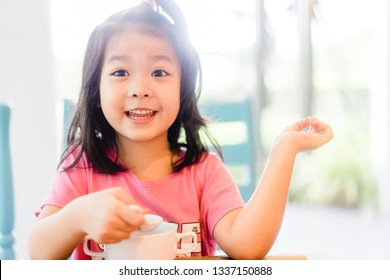 5 years old asian girl eating hong kong congee or rice porridge on breakfast time.Happy time in breakfast with asian food everyday.