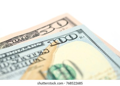 $50 and $100 banknotes on white background