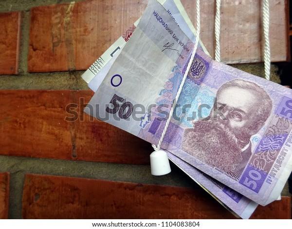 50 bills of hryvnia against the brick wall - banknotes of Ukraine fifty hryvnia, Ukraine currency. Ukrainian bill hundred UAH.