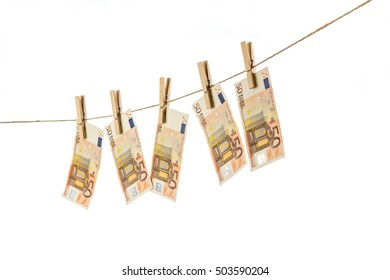 50 Euro banknotes hanging on clothesline on white background. Money laundering concept
