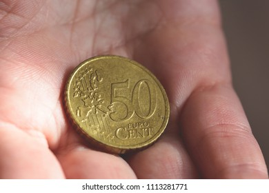 50 Euro Cent Coin in the palm of a female hands A, shallow depth of field macro photography