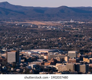 50 megapixel photo of Roanoke, Virginia skyline at sunset with Blue Ridge Mountains and airport in the background. Shot from Mill Mountain Overlook. Shot with Pentax 645z.