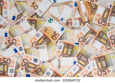 50 new and old euro bills as background